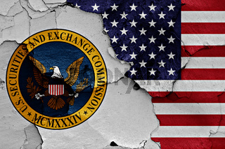flags of Securities and Exchange Commission and USA painted on cracked wall