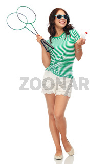 teen girl with badminton rackets and shuttlecock