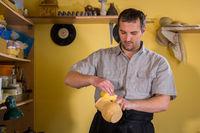 Potter preparing ceramic wares for burning