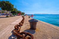 Town of Njivice Riva ship iron chain aand waterfront view