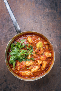 Traditional Creole cajun court bouillon with fish and seafood gumbo chowder stew as top view in a pot with