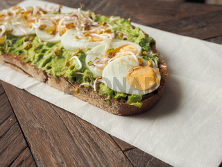 Organic bread with avocado cream and eggs