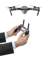 Drone and radio remote control in hands