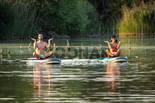 Man woman having fun paddleboarding