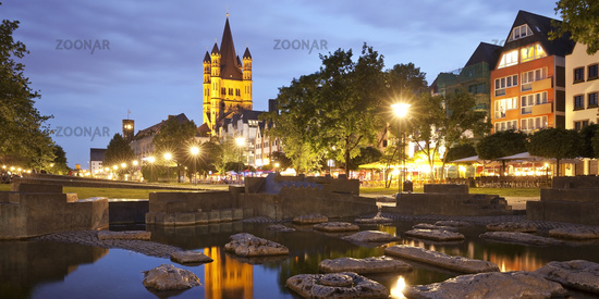 popular park Rheingarten and Great St. Martin Church in the evening, Cologne, Germany, Europe