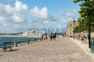view of the city walls and port of Saint-Malo with a Brittany ferry leaving