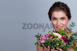 Woman with stylish make-up and flowers