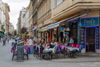 People sitting in front of restaurant in Budapest Vaci street