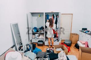Nice-looking lady inside modern apartment room prepare to trip