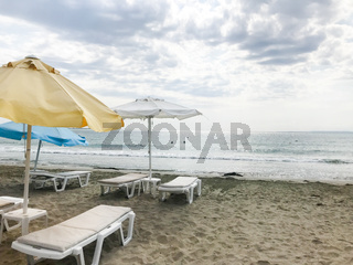 Pomorie, Bulgaria - September 12, 2019: People Relaxing On The Beach.