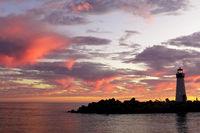 Vibrant dusk over Breakwater (Walton) Lighthouse as seen from Seabright Beach.