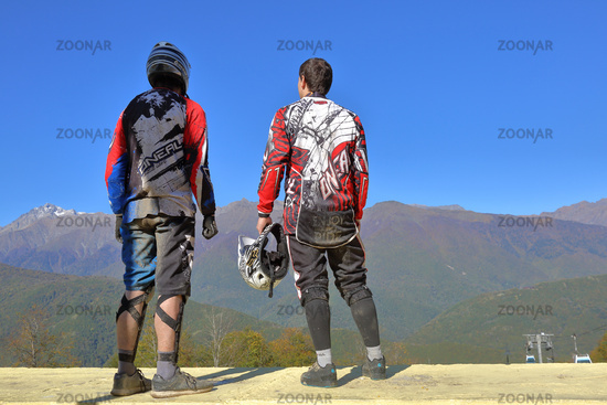 Mountain bikers stand on the observation deck