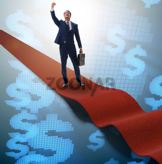 Businessman with dollars on red carpet