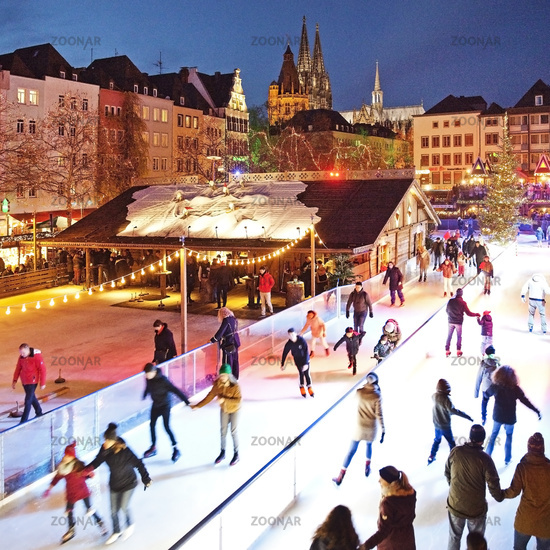 People on the illuminated ice rink on the Heumarkt, Cologne, North Rhine-Westphalia, Germany, Europe