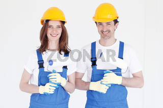 Workers with paint rollers