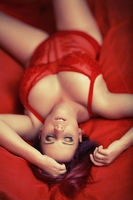 sexy red head girl in red lingerie on bed