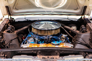 classic american muscle car under hood