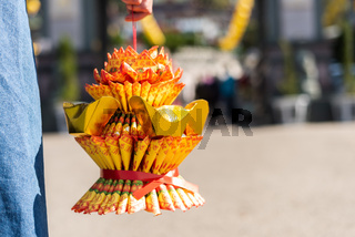 woman hold a lotus made by joss paper