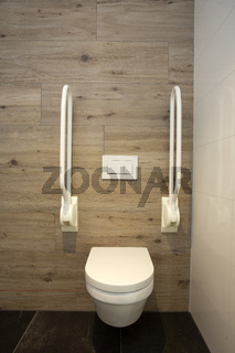 Inside disable toilet. toilet with grab bars for senior or a handicapped person,disable concept. modern design