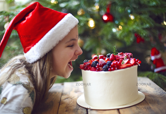 Christmas Cake decorated with berries and little girl