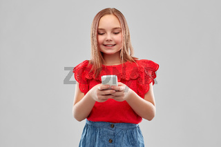 beautiful smiling girl using smartphone