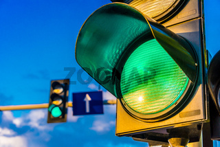 Traffic lights over urban intersection. Green light