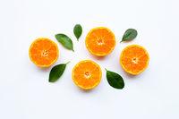 Orange fruits with  leaves on white background.