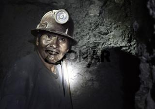 Portrait of a miner inside Cerro Rico silver mine. October 8, 2012 - Potosi, Bolivia
