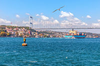 The Fatih Sultan Mehmet Bridge, the cargo ship and the Bosphorus view, Istanbul