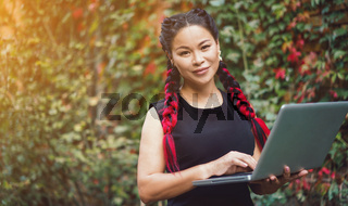 Beautiful Asian Business Woman Posing with Laptop Outdoor