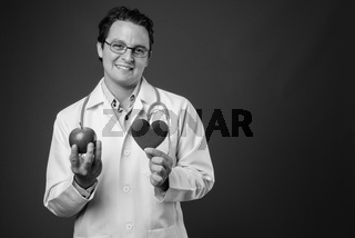 Studio shot of Italian man doctor in black and white