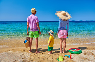 Family on beach in Greece. Summer vacation.