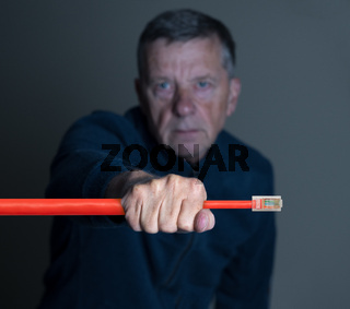 Senior man squeezing ethernet cable to illustrate net neutrality