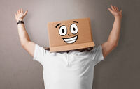 Young boy with happy cardboard box face