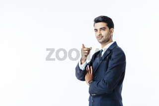 Portrait of a successful businessman in black suit and tie pointing up