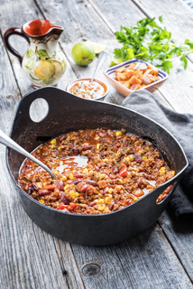 Traditional slow cooked Mexican chili con cane with mincemeat