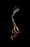 Vintage / Antique Gun and Smoke Coming Out on Black Background