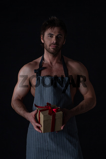 Man in apron with Valentines day gift