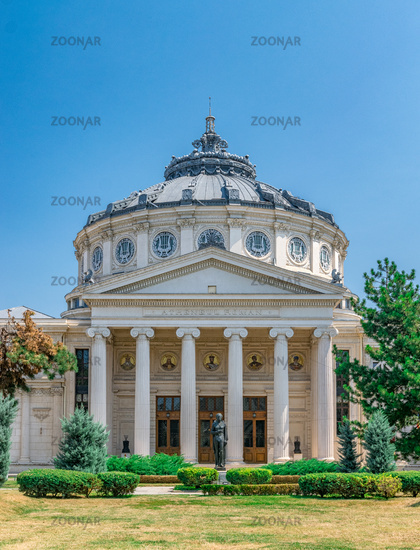 Romanian Athenaeum, a concert hall in the center of Bucharest, Romania and a landmark of the Romanian capital city. Romanian Athenaeum a sunny summer day with blue sky in Bucharest, Romania