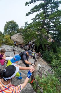 Tourists on steep mountain trail in Huashan mountain