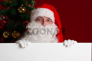 Santa Claus with white paper