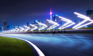 Motion blurred racetrack with city skyline background