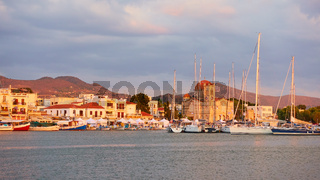 Port and waterfront in Aegina town at sunset