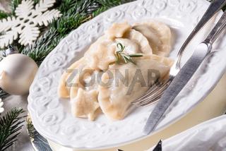 Polish style dumplings filled with sauerkraut and mushrooms
