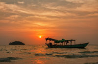 Fishing boat on background of beautiful tropical sunset