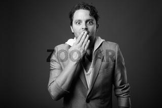 Studio shot of Italian businessman in black and white
