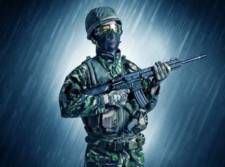 Armed soldier standing in rain