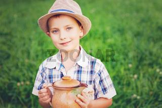 handsome little boy with jug