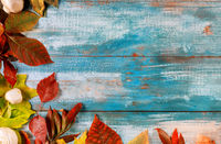 Old wooden table border from fallen leaves in the thanksgiving autumn background