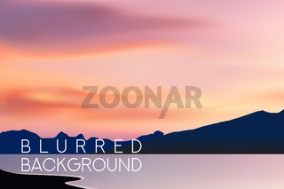 horizontal wide blurred mountain background - sunset colors With quote